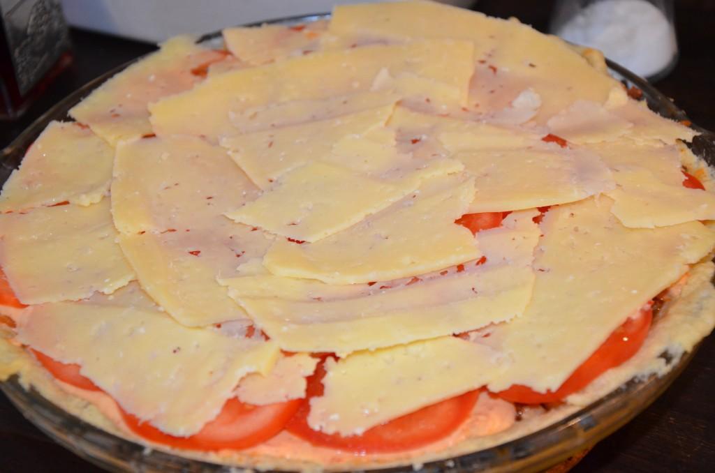 skivad ost på toppen